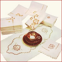 embroidered table-linen, embroidered goods